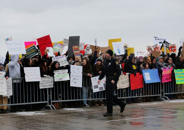 Hundreds of people rally against a temporary travel ban signed by U.S. President Donald Trump in an executive order during a protest at Detroit Metropolitan airport in Romulus, Michigan, U.S., January 29, 2017.
