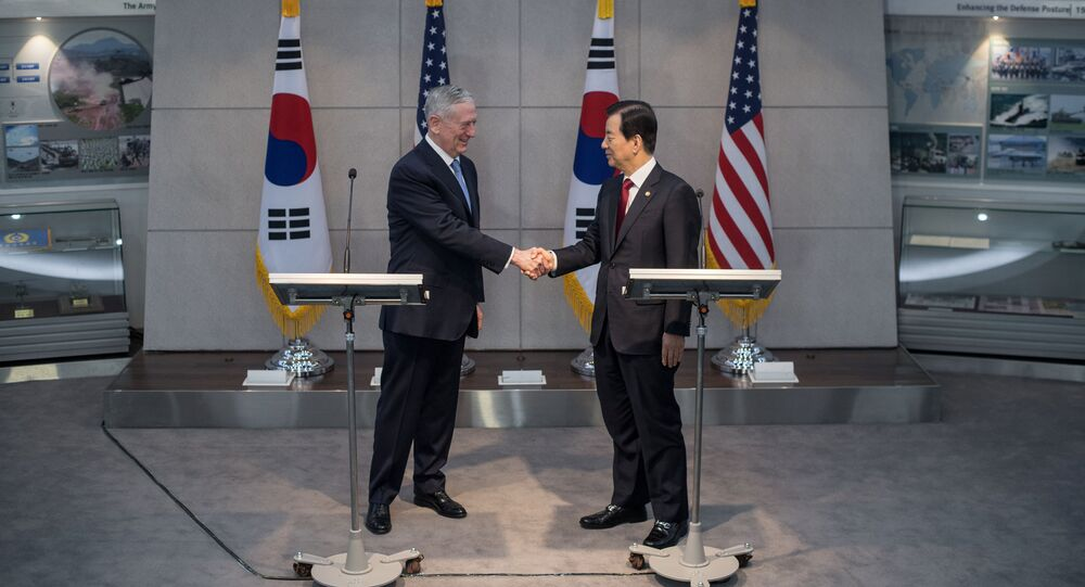 U.S. Defense Secretary James Mattis (L) shakes hands with his South Korean counterpart Han Min-Koo following a joint briefing at the Defense Ministry in Seoul on February 3, 2017