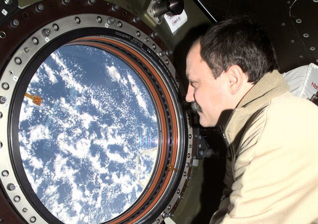 Cosmonaut Yury V. Usachev, Expedition Two mission commander, looks through the window on the Destiny laboratory onboard the International Space Station (ISS).