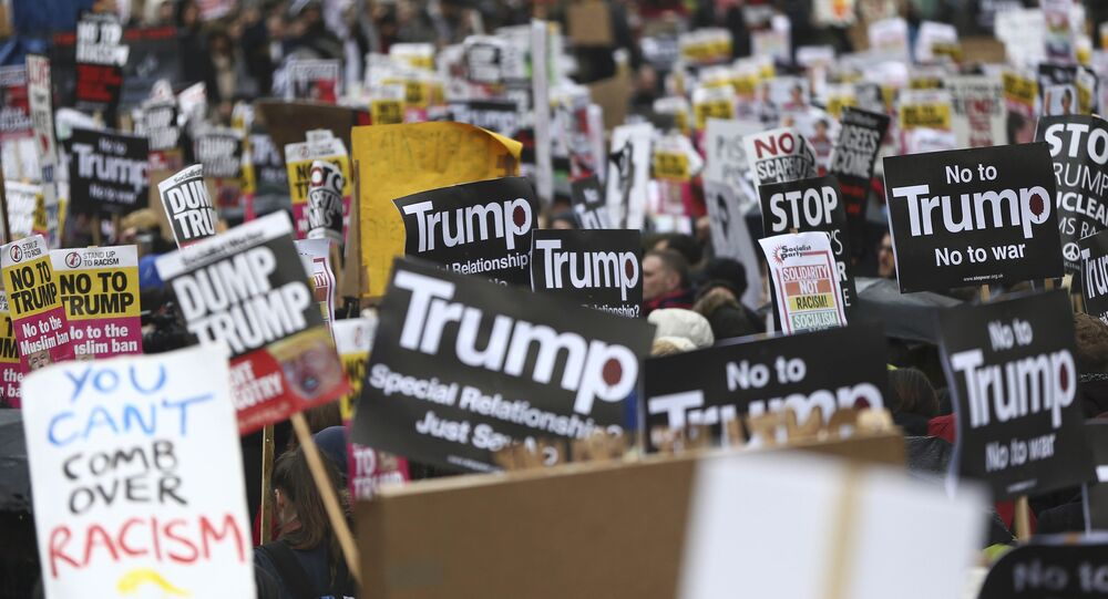Demonstrators march against U.S. President Donald Trump and his temporary ban on refugees and nationals from seven Muslim-majority countries from entering the United States, during a protest in London, Britain, February 4, 2017