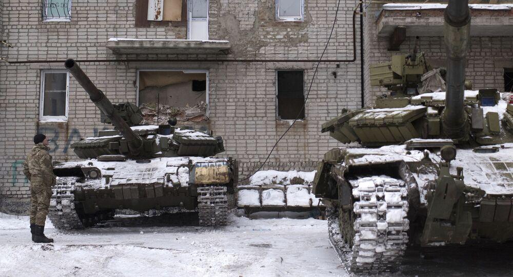 Ukrainian serviceman stands near tanks at an apartment house in Avdiivka, eastern Ukraine, Thursday, Feb. 2, 2017