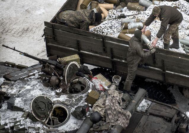 Ukrainian servicemen load ammunition into a tank in Avdiivka, eastern Ukraine, Thursday, Feb. 2, 2017