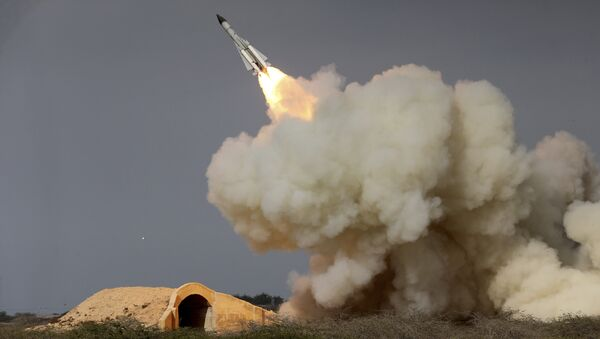 FILE -- In this Dec. 29, 2016 file photo, released by the semi-official Iranian Students News Agency (ISNA), a long-range S-200 missile is fired in a military drill in the port city of Bushehr, on the northern coast of Persian Gulf, Iran - Sputnik International