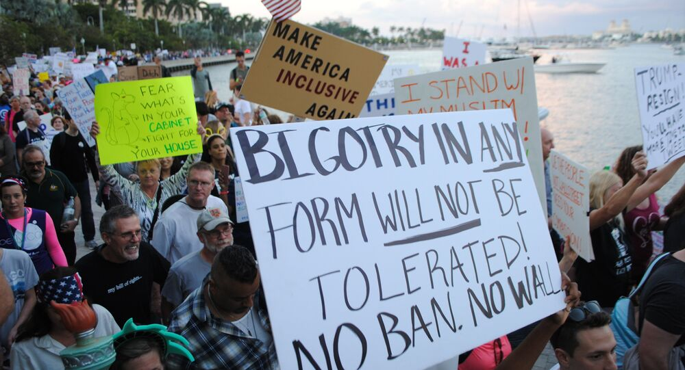 People protest outside the Trump Plaza Hotel against the executive orders issued by US President Donald Trump, February 4, 2017 in West Palm Beach, Florida