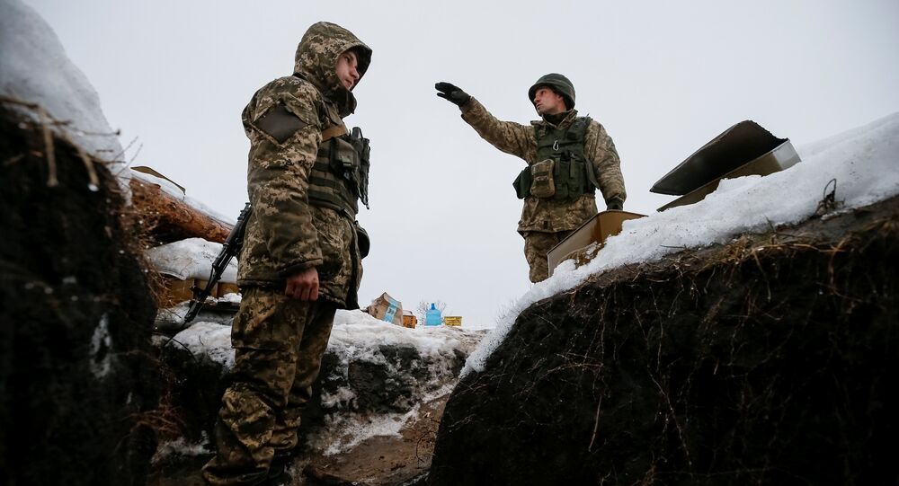 Ukrainian servicemen are seen at their position on the front line near the government-held industrial town of Avdiyivka, Ukraine February 4, 2017