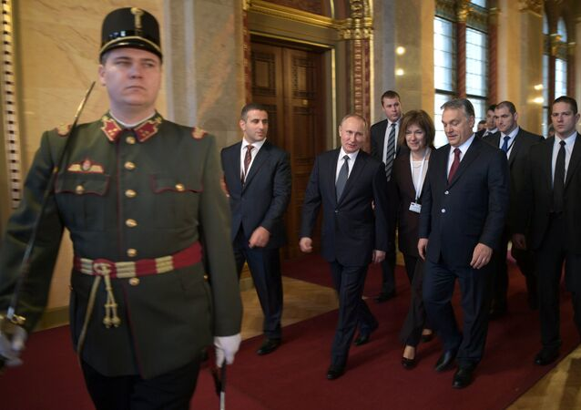 February 2, 2017. From right in the background: Russian President Vladimir Putin and Hungarian Prime Minister Viktor Orban during their meeting in Budapest