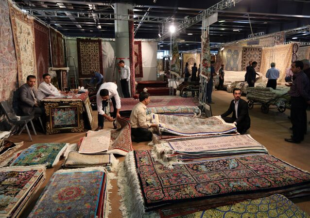 Iranian vendors and customers are seen at Iran's international hand-woven carpet exhibition in Tehran on August 26, 2015