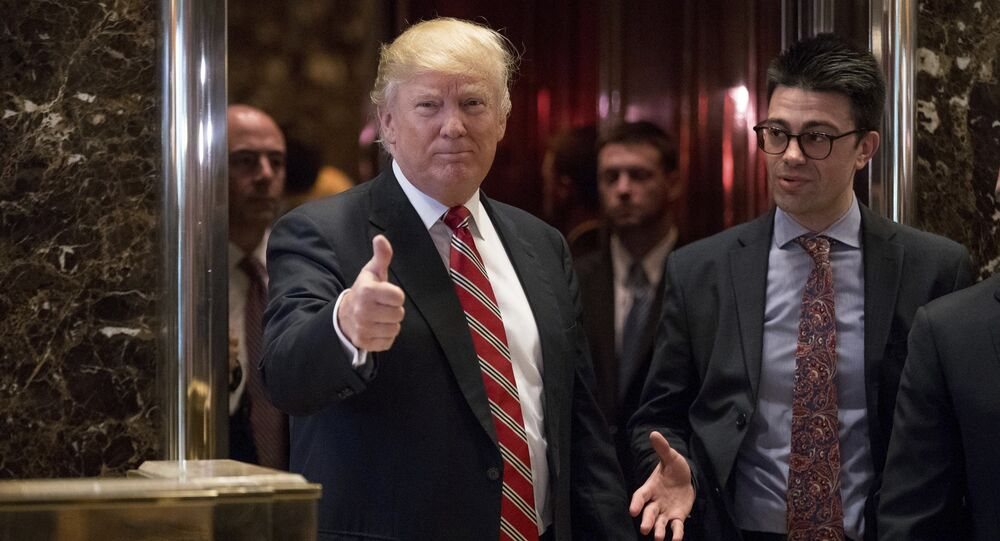 President-elect Donald Trump gives a thumbs up to members of the media after meeting with Martin Luther King III, son of Martin Luther King Jr., at Trump Tower in New York, Monday, Jan. 16, 2017