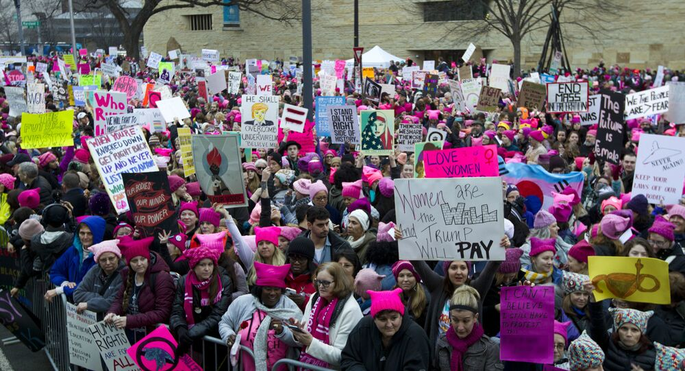 Women with bright pink hats and signs begin to gather for a protest against Donald Trump's presidency, Saturday, Jan. 21, 2017 in Washington, DC. Earlier this year, US media reported that Soros contributed $246 million to partners of the Women's March.