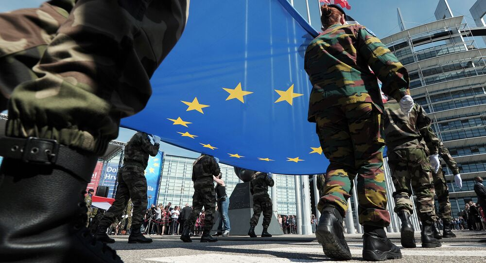 Members of Eurocorps military contingent hold the Europeen flag during a ceremony for Croatia's accession to the European Union on July 1, 2013, in the European Parliament in Strasbourg, eastern France