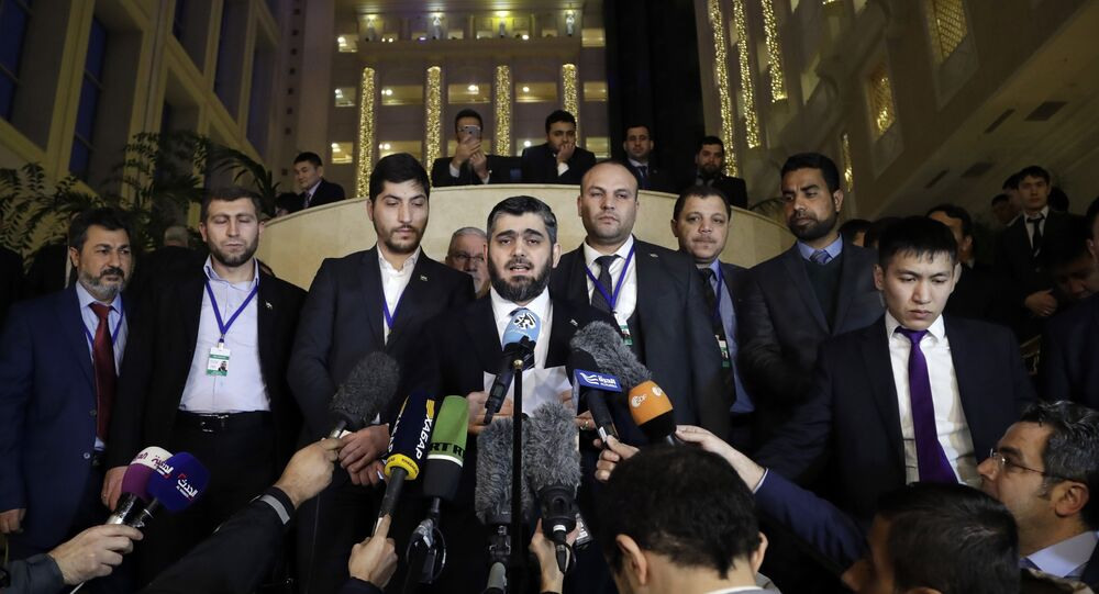 Mohammed Alloush, head of a Syrian opposition delegation, center, speaks to the media after the talks on Syrian peace in Astana, Kazakhstan.
