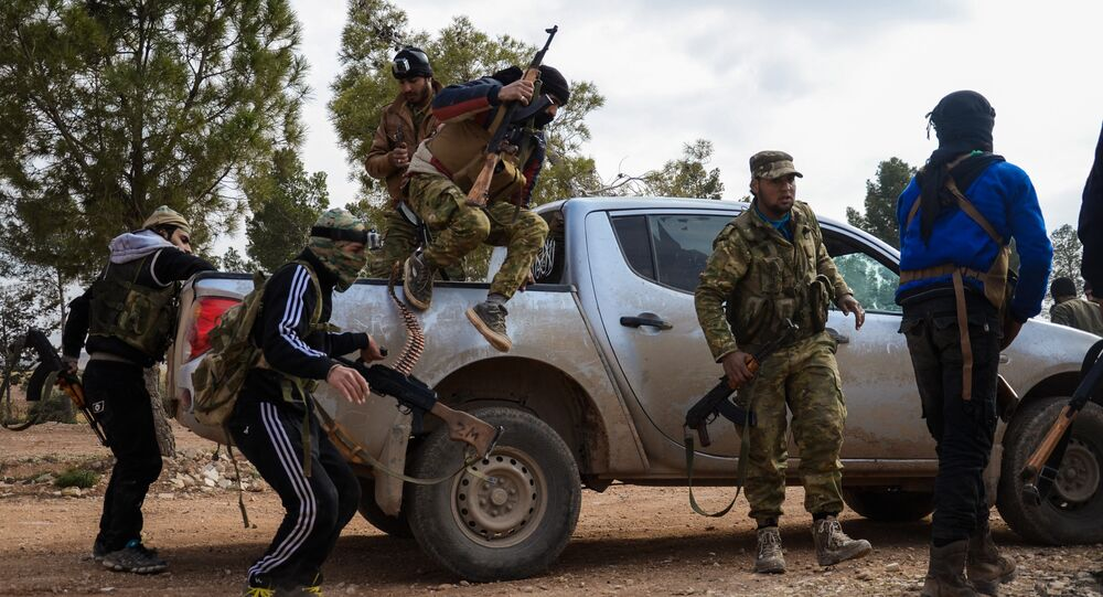 Fighters from the Free Syrian Army disembark from an armoured vehicle near the town of Bizaah northeast of the city of Al-Bab, some 30 kilometres from the Syrian city of Aleppo, on February 4, 2017