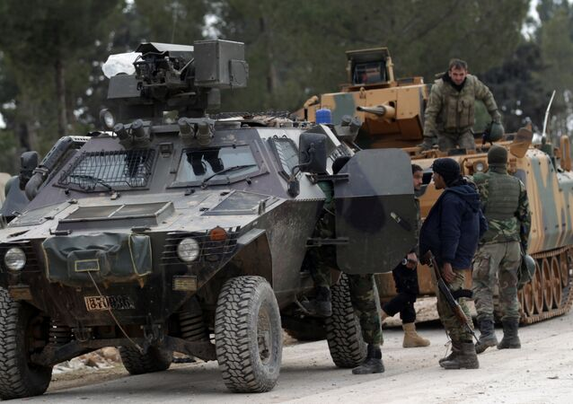 Turkish forces and members of the Free Syrian Army are seen at the al Baza'a village on the outskirts of al-Bab town in Syria February 4, 2017