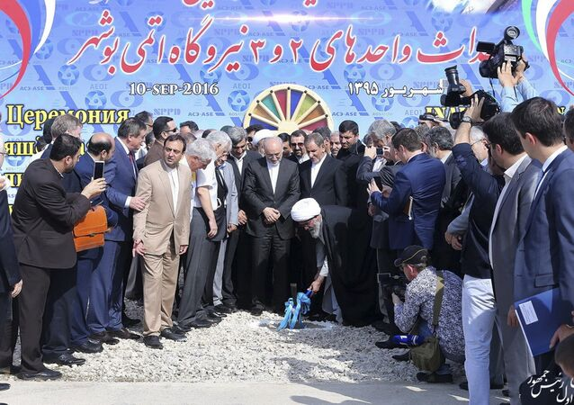 Iranian Senior Vice-President on Saturday, Sept. 10, 2016, Ayatollah Gholam Ali Safaei Bushehri, Supreme Leader Ali Khamenei's representative in Bushehr province, center bottom, breaks ground in a ceremony to begin building Iran's second nuclear power plant in the southern port city of Bushehr, Iran