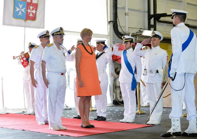 Italian defence minister Roberta Pinotti (C) is greeted by marines as she arrives aboard the Italian navy's aircraft carrier Cavour (File)