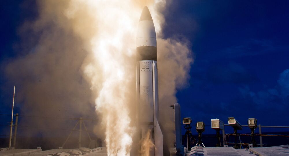 The first SM-3 interceptor in a double shot missile defense test rockets skyward to strike out a ballistic missile target off the coast of Kauai, Hawaii.