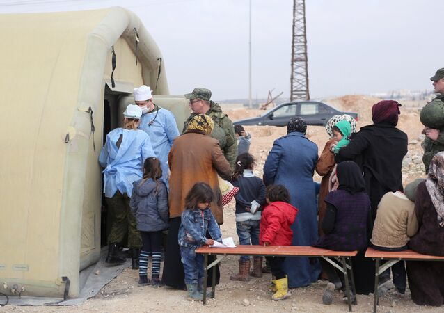 Syria. Treating people at the Jibrin temporary refugee accommodation center in Aleppo. This re-cropped photo courtesy of the Russian Center for Reconciliation of the Warring Parties in Syria