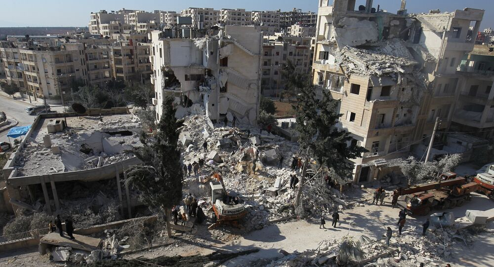 People inspect the damage at a site hit by airstrikes in the rebel-held city of Idlib, Syria February 7, 2017