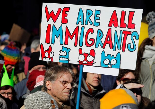 A demonstrator holds a sign to protest against U.S President Donald Trump's executive order banning refugees and immigrants from seven primarily Muslim countries from entering the United States during a rally in Philadelphia, Pennsylvania, U.S. February 4, 2017