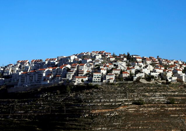 Houses are seen atop a hill in the Israeli settlement of Givat Ze'ev, in the occupied West Bank February 7, 2017