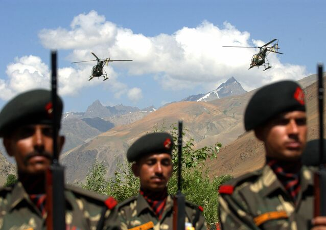 Indian Airforce helicopters fly over soldiers