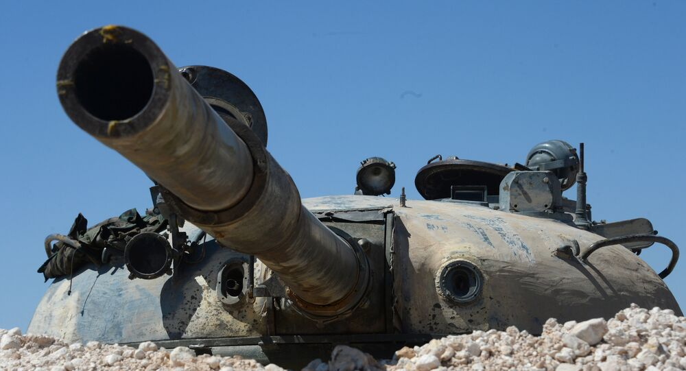 A T-55 tank aids pro-government militia forces outside the terrorist-held town of Al-Karyatein, Syria.