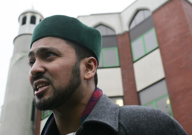 Imam Ajmal Masroor speaks to the media outside the Finsbury Park mosque in North London, Friday, Jan. 13, 2006.