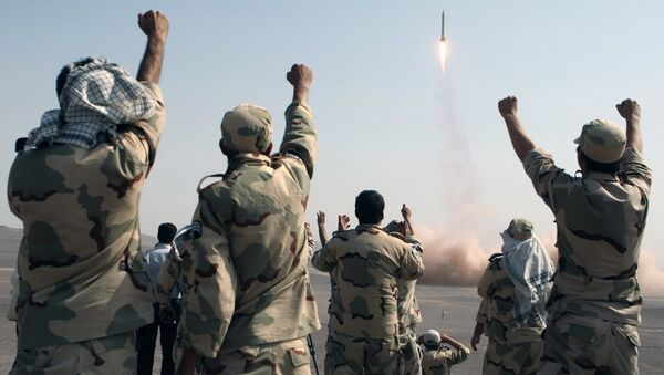 In this photo released by the Islamic Republic News Agency (IRNA), members of the Iranian Revolutionary Guard celebrate after launching a missile during their maneuver in an undisclosed location in Iran (File) - Sputnik International