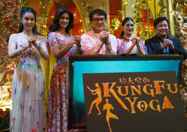 The cast of Kung Fu Yoga, from left, Miya Muqi, Disha Patani, Jackie Chan, Amyra Dastur and Stanley Tong pose for a group photo during an event to promote their new movie Kung Fu Yoga at a shopping mall in Kuala Lumpur, Malaysia, Saturday, Jan. 21, 2017.