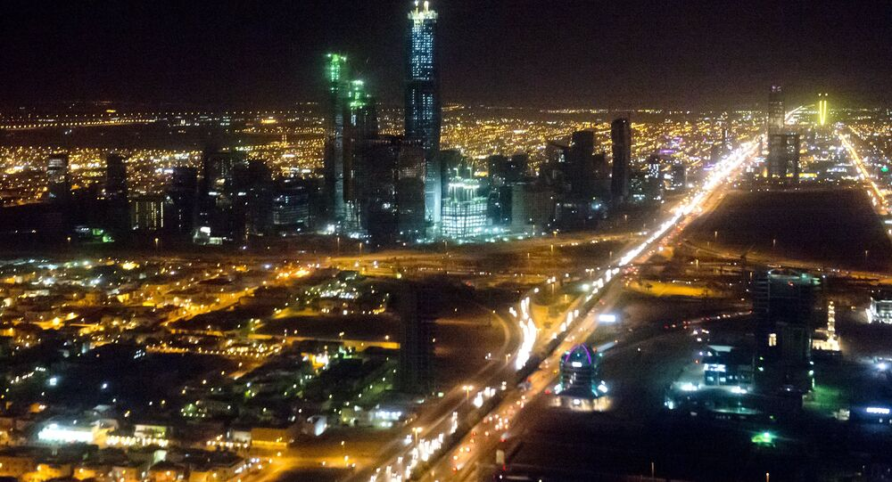 The skyline of Riyadh, Saudi Arabia is seen at night in this aerial photograph from a helicopter.
