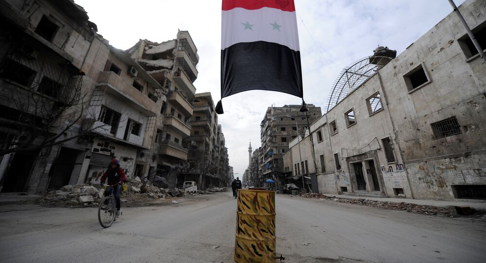 A Syrian national flag hangs in a damaged neighbourhood in Aleppo, Syria January 30, 2017