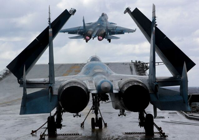 Su-33 and MiG-29K fighters aboard Admiral Kuznetsov heavy aircraft carrier in the Mediterranean Sea.