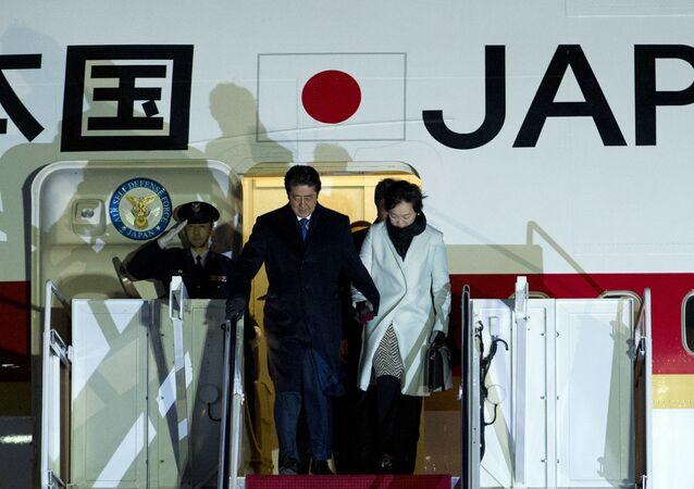 Japanese Prime Minister Shinzo Abe and his wife Akie steps off from their plane upon they arrival at Andrews Air Force Base, Md., Thursday, Feb. 9, 2017.