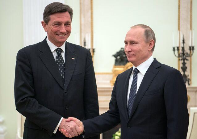 Russian President Vladimir Putin meets with Slovenia's President Borut Pahor, left