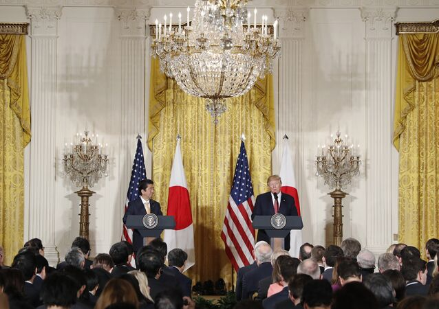 President Donald Trump and Japanese Prime Minister Shinzo Abe participate in a joint news conference in the East Room of the White House in Washington
