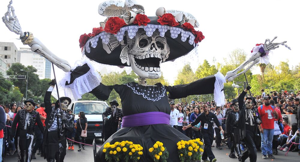 Floats depicting Catrinas and other death related characters and offerings march during the first Big Parade of the City to celebrate the Day of the Dead in Mexico City on October 29, 2016.