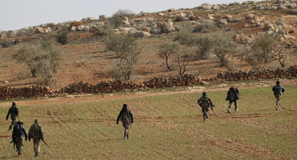 Free Syrian Army fighters are seen in al Baza'a village in the outskirts of al-Bab town, Syria