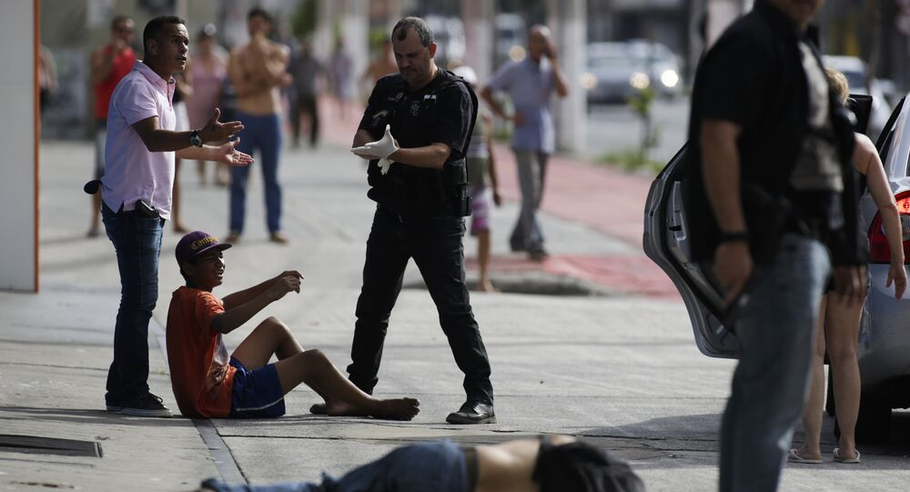 Civil police detain looters after they were shot in their legs, in Vitoria, Espirito Santo state, Brazil, Monday, Feb 6, 2017. Protests by the friends and family of military police in Espirito Santo have led to an increase in crime and forced the shut-down of some state services, authorities said Monday.