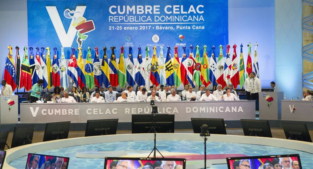 Ecuadorean President Rafael Correa is seen at screens as he speaks at the plenary session during the Fifth Summit of the Community of Latin American and Caribbean States (CELAC) in Bavaro, Dominican Republic, on January 25, 2017