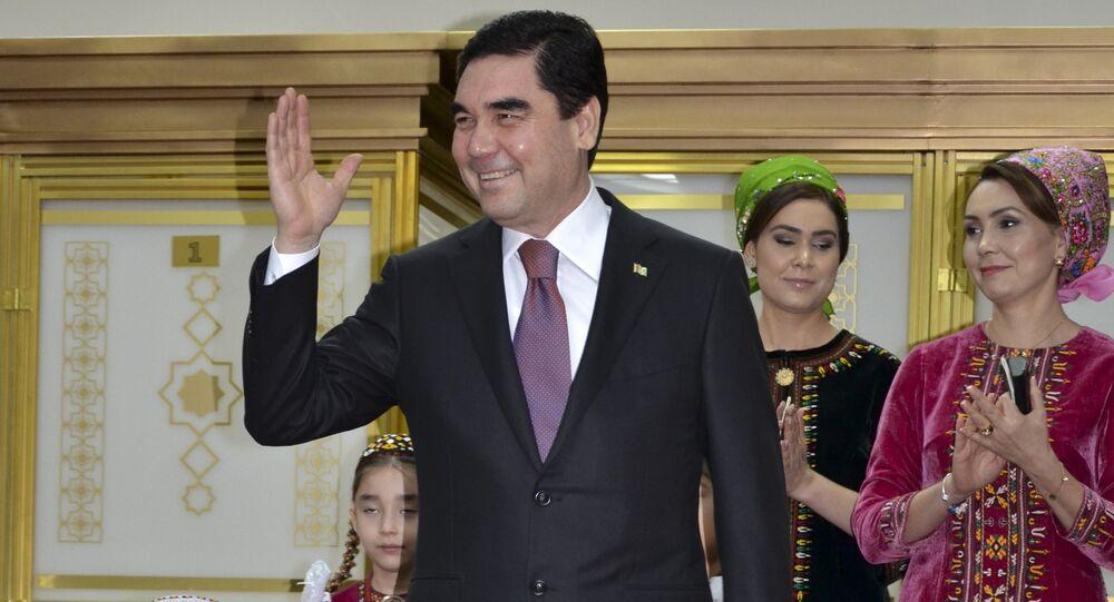 Turkmenistan President Gurbanguly Berdimuhamedov, center, greets journalists after casting his ballot at a polling station in Ashgabat, Turkmenistan, Sunday, Feb. 12, 2017
