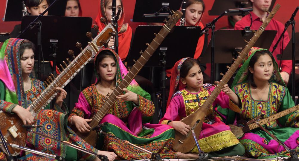 Afghanistan's first all-female orchestra performs during the closing ceremony of the World Economic Forum on January 20,2017 in Davos