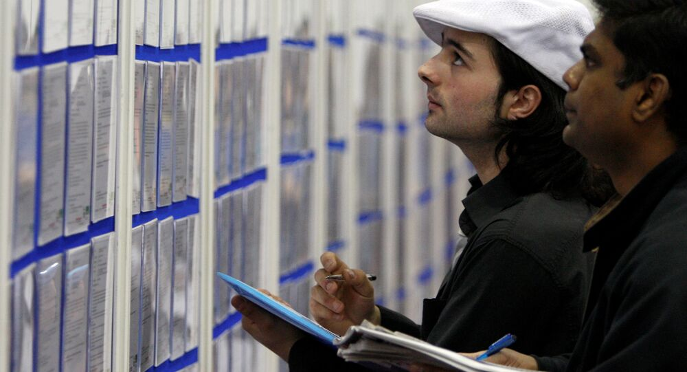 People look at job listings at the Careers and Jobs Live careers fair at the ExCeL centre in London (File)
