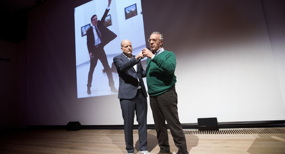 Winner of the World Press Photo 2016 photographer Burhan Ozbilici (R) and Managing Director of the World Press Photo Foundation Lars Boering, speak on stage during the announcement of the World Press Photo prizes in Amsterdam, on February 13, 2017