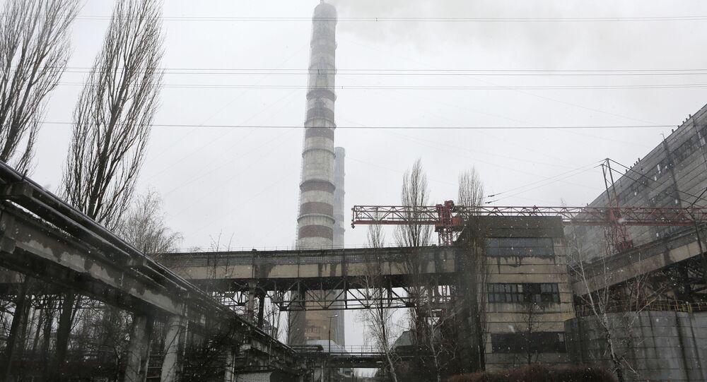 Steam rises from a smokestack at the Trypillya thermal power plant in Ukrainka, about 50 kilometers (31.3 miles) south of Kiev, Ukraine, Thursday, Feb. 11, 2016