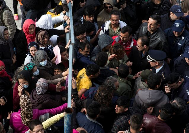 Refugees and migrants, most of them Afghans, block the entrance of the refugee camp at the disused Hellenikon airport as police officers try to disperse them, in Athens, Greece, February 6, 2017