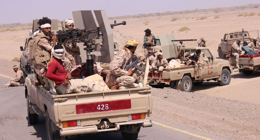 Members of the Yemeni army ride on the back of military trucks near the Red Sea coast city of al-Mokha, Yemen January 23, 2017