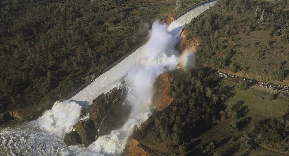 An aerial photo of the burst of California's Oroville Dam.