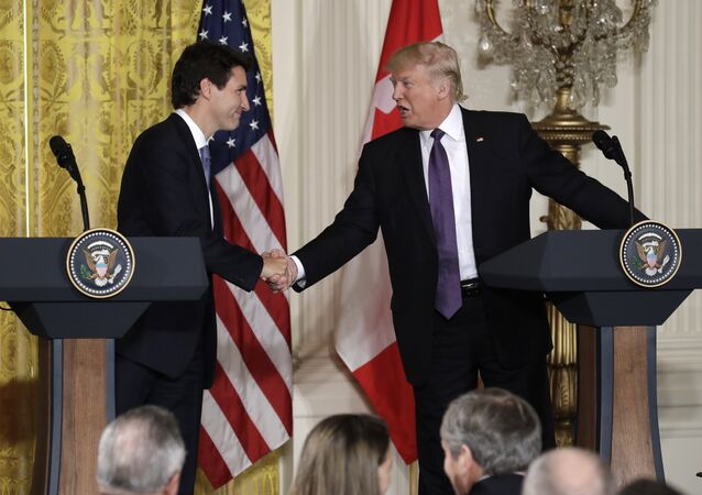 President Donald Trump shakes hands with Canadian Prime Minister Justin Trudeau during their joint news conference in the East Room of the White House