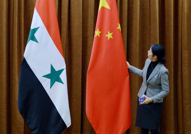 Syrian and Chinese flags (File)