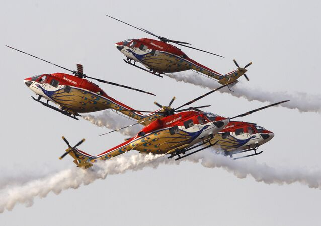Indigenously manufactured Indian Air Force Dhruv helicopters perform an aerobatic manoeuvre  at Yelahanka air base in Bangalore (File)